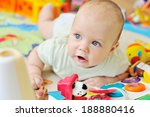 baby on the carpet with toys | Shutterstock . vector #188880416