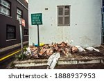 Small photo of Abandoned depraved city district with waste and broken windows in Cape Town, South Africa