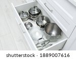 Open Drawer With Pots And Pan...