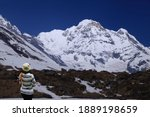 Woman Standing On Snow Trekker...