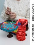 Small photo of Plasticine modelling clay. Dress, table, face in hands. Home developing activities, creative idea, hobby. Plasticine sculpture. Sculpts from plasticine modelling clay. Create toy, shapes of plasticine
