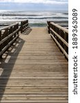 A Wooden Boardwalk And Beach...