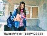 Young hispanic student girl...