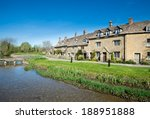 Cottages By A Stream In The...