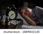 Depressed Senior Woman Lying In ...