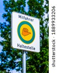 Small photo of Hitchhiker stop sign in germany - translation: Hitchhiker stop
