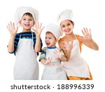 Three Young Chefs With Raised...