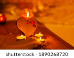 Wooden Heart And Candles On...