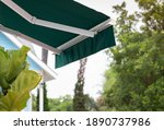 Green Awning Of Shop With...