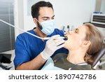 during work. careful dentist... | Shutterstock . vector #1890742786