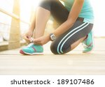 young runner tying shoe lace on ... | Shutterstock . vector #189107486