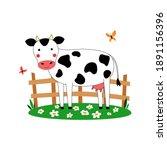 A Cute Cow Grazes In A Green...