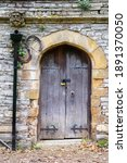 Old Wooden Arched Doors In A...