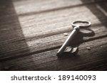 Rusty Old Skeleton Key On Dark...