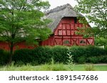 Old Red Thatched Roof House