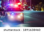 Sport Utility Vehicle Police Cruiser Emergency Assistance on the City Street. Police Car with Flashing Lights. - stock photo