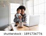 single mom having a video call... | Shutterstock . vector #1891736776