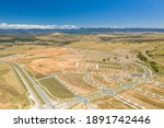 Small photo of Aerial drone view of new road development and residential construction site in the newly established suburb of Whitlam in Canberra, the capital city of Australia