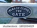 Close Up Of Please Close The...