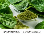 Small photo of dry spinach powder on white background. Green Powder. Could be any Green Super Food. Perhaps spirulina, chorella, barley grass, dried broccoli, spinach.