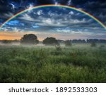 Rainbow Over A Meadow In The...