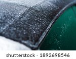 Modern Automotive Materials and Weather Elements. Fabric Convertible Car Roof Covered by Frost and Ice. Transportation Industry. - stock photo