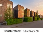 Street with modern houses in a suburban area - stock photo