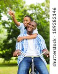 happy african lovers riding a... | Shutterstock . vector #189282146