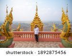 Asian Woman With Wat Phra That...