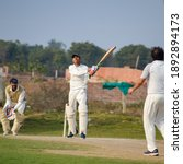Small photo of New Delhi India – July 01 2018 : Full length of cricketer playing on field during sunny day in local playground, Cricketer on the field in action, Players playing cricket match at field