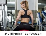 sporty girl in the gym | Shutterstock . vector #189303119