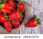 fresh strawberries on old... | Shutterstock . vector #189322574