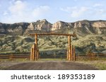A Wooden Ranch Gate In Front O...