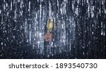 Small photo of Festive silver glint shimmery tinsel rain background with a hand holding a glass full of sparkling white wine in the spotlight. High-quality photo.
