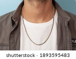Silver Necklace On Man's Neck...