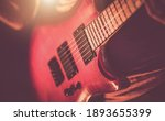 Music Industry Theme. Rockman Guitarist Playing Hard. Musician with Electric Guitar in His Hands Close Up. - stock photo