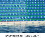 plastic seats and pool with water - stock photo