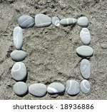 square pebble frame lying on a sand - stock photo