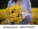 A Woman Holding A Chrysanthemum ...