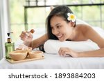 asian woman lying down on... | Shutterstock . vector #1893884203