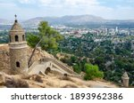 A beautiful shot of the stone cross tower in the Mount Rubidoux trail in California