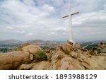 A beautiful shot of the cross on a rocky mountain of Mount Rubidoux in California