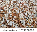 White And Brown Pebbles Are...