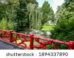 Red Wooden Fence  Lake With...