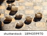 Old Rough Stone Checkers Close...