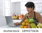 young asian man eating salad... | Shutterstock . vector #1894573636