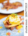 Small photo of egg benedict with crispy bacon for breakfast,egg benedict