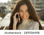 smiling beautiful woman talking ... | Shutterstock . vector #189506498