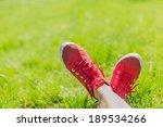 Feet In Sneakers In Green Grass....