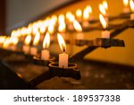 row of burning candles in the... | Shutterstock . vector #189537338